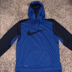 Blue Nike sweatshirt.